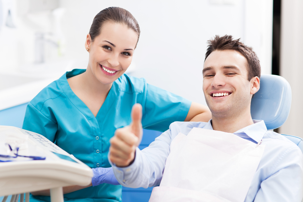 Dental Patient Giving a Thumbs Up