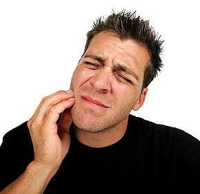 Man in pain from wisdom teeth